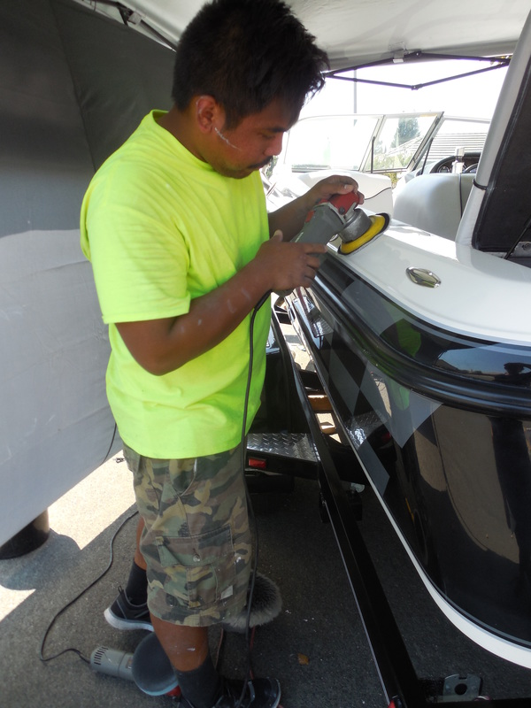 ken of detail pros doing oxidation removal and gel coat restoration on this centurion ski boat in yuba city