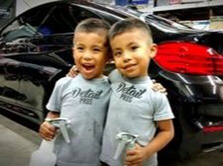 family pic of detail pros kids while doing a detail on a bmw m4 in yuba city