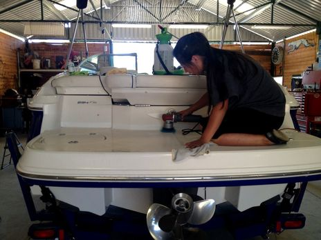 caryn of detail pros cleaning and detaiing a boat in browns valley
