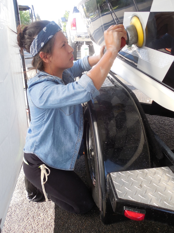 caryn of detail pros doing some oxidation removal and polishing work on this boat detail in yuba city